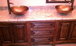 Bathroom sink after Sovereign Quality Custom Remodelers .... Custom stone countertops, custom cabinets, stained cabinets